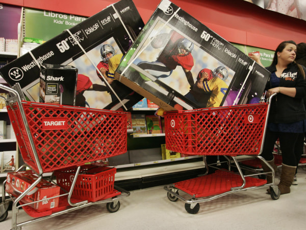 Victoria Wachowiak pushes a shopping cart with a 50-inch televison at Target