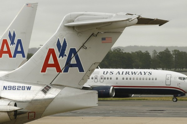 Shares in US Airways were halted Tuesday, amid reports that the airline and its prospective merger partner AMR were close to settling a state and fede...