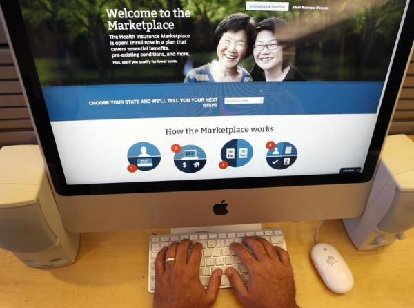 A man looks over the Affordable Care Act (commonly known as Obamacare) signup page on the HealthCare.gov website in New York in this October 2, 2013 p...