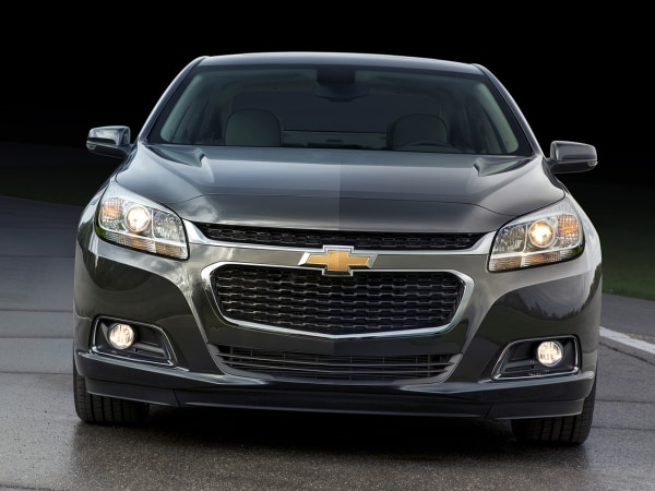 The 2014 Malibu's front fascia features a new, more prominent lower grille and the hood extends down and over the leading edge of a narrower upper g...