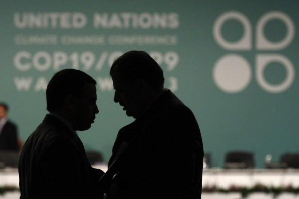 Delegates talk during a break in a plenary session at the 19th conference of the United Nations Framework Convention on Climate Change (COP19) in Warsaw. The divide is deep between rich and poor countries over who should pay for climate change aid.
