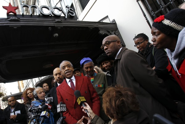 Rev. Al Sharpton, center, speaks to the media outside Macy's department store after meeting with company officials in New York in this Nov. 4, 2013, file photo. The New York City Council is asking 17 retailers about their policies as it looks into allegations of racial profiling.