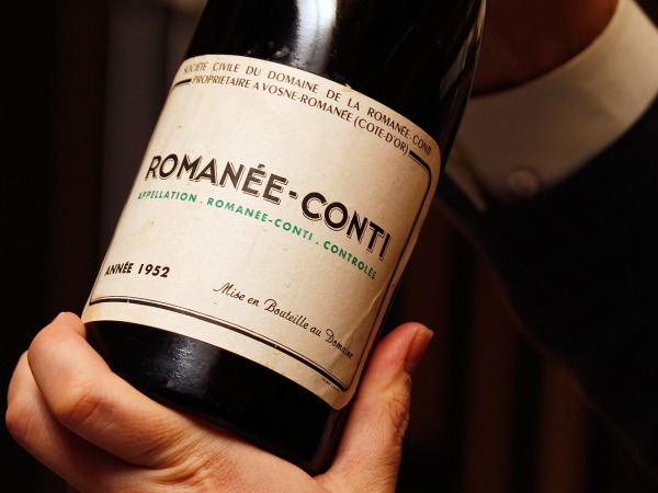 A Domaine Romanee Conti (DRC) wine bottle from 1952 is shown as part of a super lot of 55 bottles of every vintage of DRC released between 1952 and 20...
