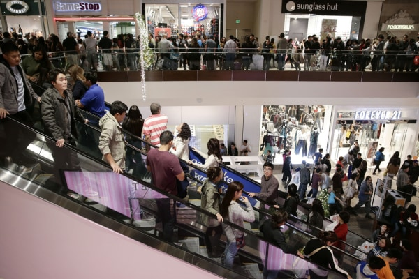 Shoppers throng Brea Mall during Black Friday shopping on Friday, Nov. 29, 2013, in Brea, Calif.