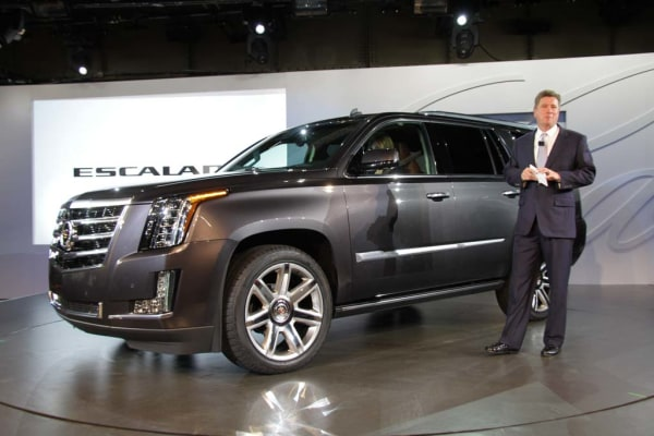 Cadillac's global chief Bob Ferguson is seen with the all-new 2014 Cadillac Escalade at its New York City preview Oct. 7, 2013.