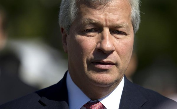 Jamie Dimon, chairman and CEO of JPMorgan Chase, arrives at the White House in Washington, Oct. 2, 2013, for a meeting of the Financial Services Forum with President Barack Obama. JPMorgan Chase reported its first quarterly loss under his tenure on Friday.