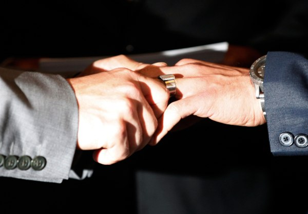 Plaintiffs in the California's Proposition 8 case Paul Katami (R) and Jeff Zarrillo exchange wedding rings in Los Angeles, California in this June 28,...