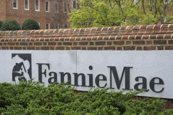 Fannie Mae and Freddie Mac can continue to fund bigger mortgages for now, federal regulators said.