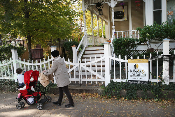 CHICAGO, IL - OCTOBER 28:  A person pushes a stroller past a  home that is offered for sale in the Wicker Park neighborhood on October 28, 2013 in Chi...