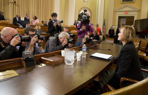 Photographers surround Marilyn Tavenner, the administrator of the Centers for Medicare and Medicaid Services as she prepares to testify on Capitol Hill.