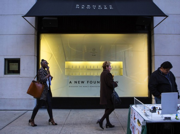People walk by a Barneys New York retail store in New York October 24, 2013.  A civil rights organization on Thursday demanded a meeting with the CEO ...