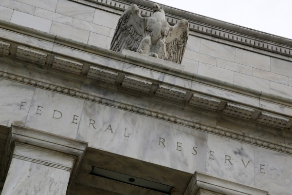 An eagle tops the U.S. Federal Reserve building's facade in Washington, in this July 31, 2013, file photo.