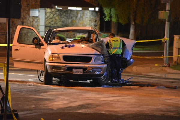 This photo provided by Robert Petersen shows police inspecting a very bent pickup truck at the scene of a five-car accident in Lodi Calif. Tuesday Oct...