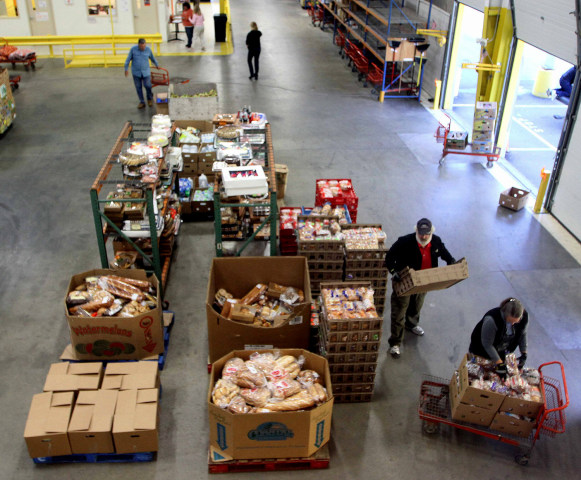 Volunteers gather food at the New Hampshire Food Bank in Manchester, N.H., to be delivered around the state. The temporary increase in food stamps expires Oct. 31, meaning for millions of Americans, the benefits that help them put food on the table every month won't stretch as far as they have for the past four years.