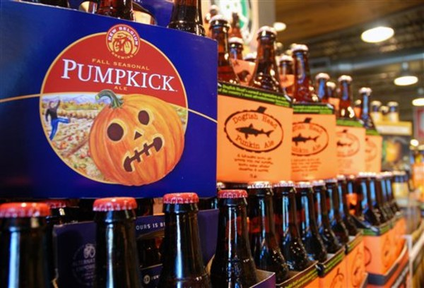 This Friday, Aug. 30, 2013 photo shows pumpkin beers on display for sale at a Whole Foods Market in Richmond, Va.  Labor Day may be considered the uno...
