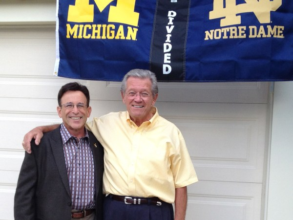 Leo Staudacher, a fellow who had a heart attack two years at a UofM/Notre Dame football game.                   It's taken with the man who performed CPR and saved Stau...