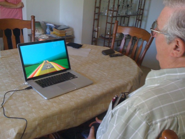 Participant playing NeuroRacer at home.                    Credit: The Gazzaley Lab/University of California, San Francisco