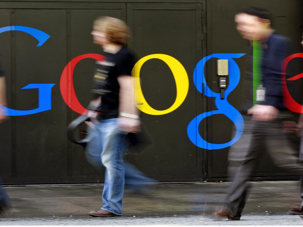 People walk past a logo next to the main entrance of the Google building in Zurich in this March 9, 2011 file photo. Hackers likely based in China tri...