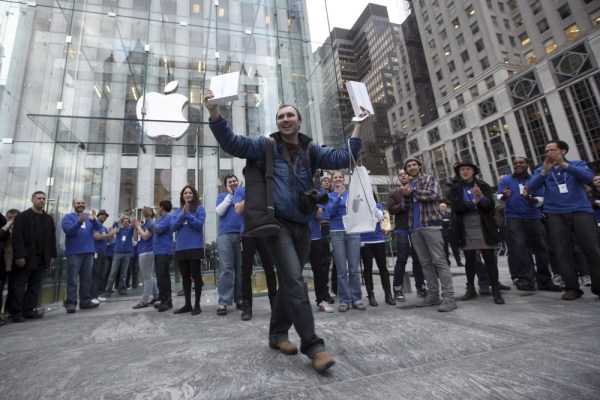Alex Shumilov of Moscow is the first customer to walk out of the Apple store on Fifth Avenue in New York after purchasing two iPad 2s Friday, March 11...
