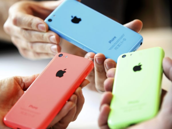People check out several versions of the new iPhone 5C after Apple Inc's media event in Cupertino, California September 10, 2013. REUTERS/Stephen Lam ...