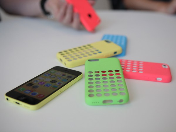 An iPhone 5C on display with its colorful cases at Apple's launch event in Cupertino, Calif. on Sept. 10.