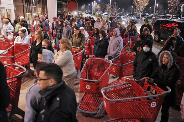 FILE- In this  Friday, Nov. 25, 2011, file photo, a crowd of shoppers wait outside the Target store in Lisbon, Conn., before the store opens for Black...