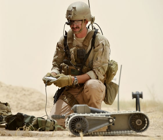 100712-N-0490C-003                 TIKRIT, Iraq (July 12, 2010) A Sailor assigned to Explosive Ordnance Disposal Mobile Unit (EODMU) 2 operates a small unmanned groun...
