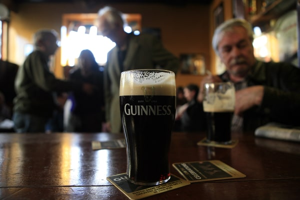 Customers enjoy a pint of stout as they celebrate Arthur's Day in Slattery's Bar in Rathmines, Dublin, September 24, 2009. Arthur's Day is the 250th b...
