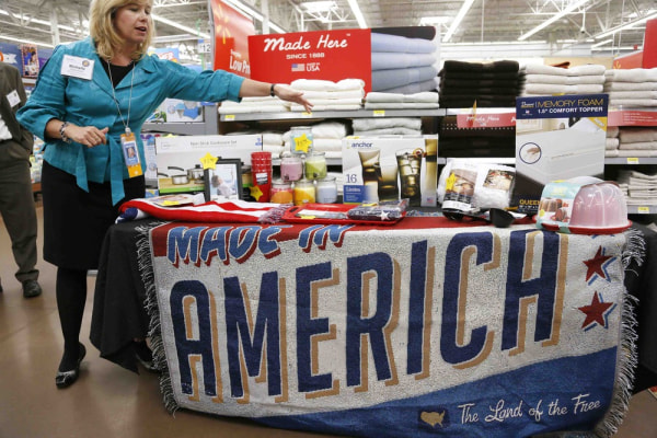 Michelle Gloeckler, senior vice-president of the home division at Wal-Mart Stores Inc, shows off a selection of merchandise made in the U.S. for sale ...