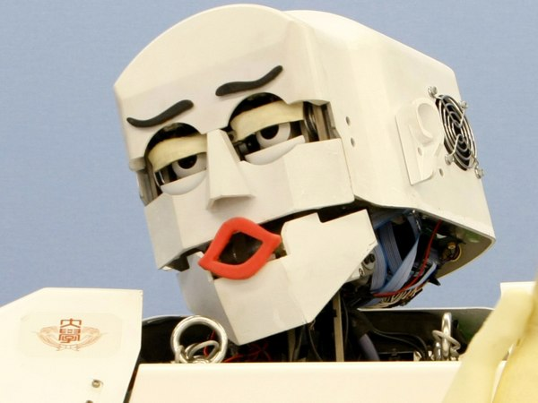 """Humanoid robot KOBIAN shows emotional display of """"disgust"""" during a demonstration at Waseda University in Tokyo, Japan, Tuesday, June 23, 2009. KOBIAN..."""