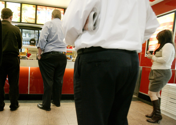 Customers wait for lunch orders at a fast-food outlet in Sydney. The World Health Organization says more than 1 billion adults around the world are overweight and 300 million of them are obese. A new study shows a clear link between obesity and eating fast food.