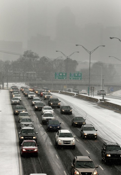 Image: Drivers pack the roads as they leave downtown Charlotte, N.C.