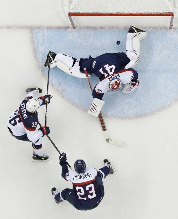USA forward Paul Stastny (26) shoots past Slovakia goaltender Jaroslav Halak (41) for a goal as Slovakia defenseman Rene Vydareny (23) looks on during the 2014 Winter Olympics men's ice hockey game on Feb. 13.