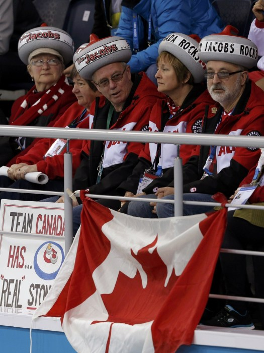 Image: Fans of Canada attend their men's curling round robin game against Norway at the 2014 Sochi Winter Olympics
