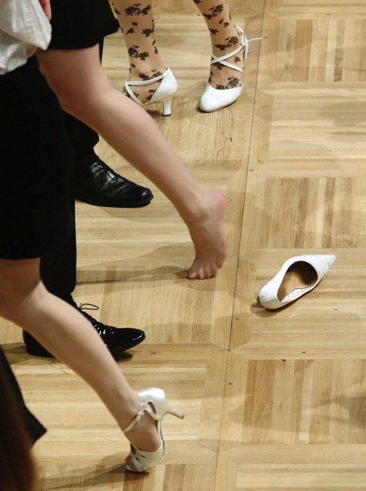 Image: Members of the opening committee dance past a lost shoe during the final rehearsal for the Opera Ball inside the opera house in Vienna