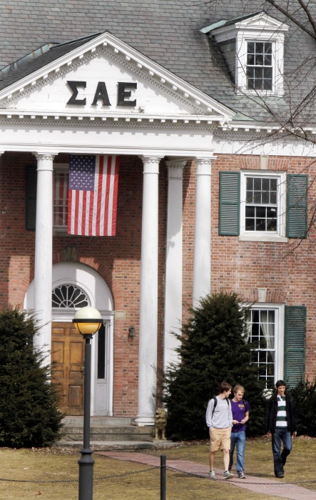 Image: Students leave the Sigma Alpha Epsilon fraternity on the Dartmouth College campus in Hanover, N.H