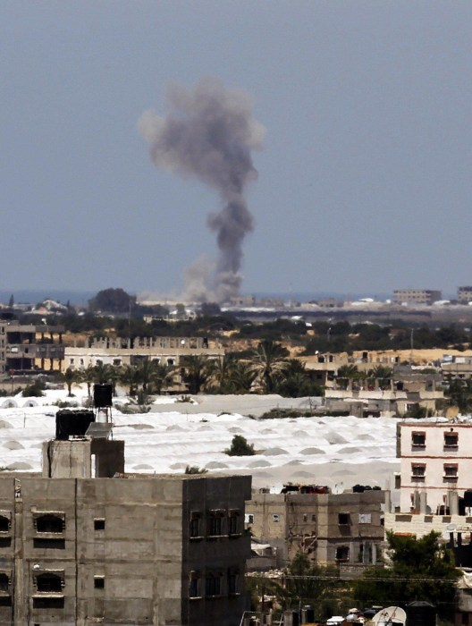 Image: Smoke rises following Israel strike on Rafah in the Gaza Strip on Monday