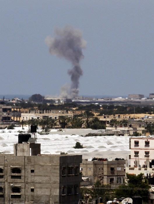 Image: Smoke rises following Israel strike on Rafah in the Gaza Strip on Monday