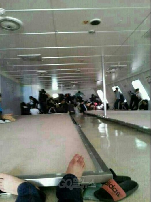 Passengers wait for rescue aboard inside the Sewol ferry as it sinks in this image posted to a social media site by a student on the ship.