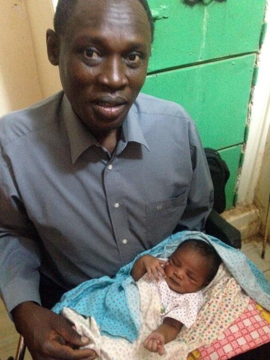 Image: Daniel Wani with newborn daughter Maya