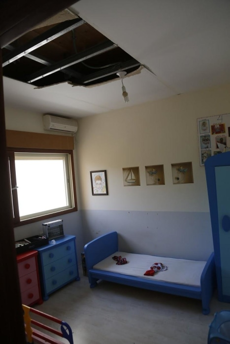 Part of the ceiling collapsed in a child's room in Iris Zilberman's home from the shock wave of a Hamas rocket that landed in the yard next door.