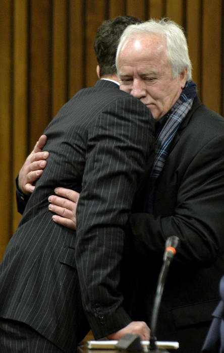 Image: Oscar Pistorius gets a hug from his father in the Pretoria High Court