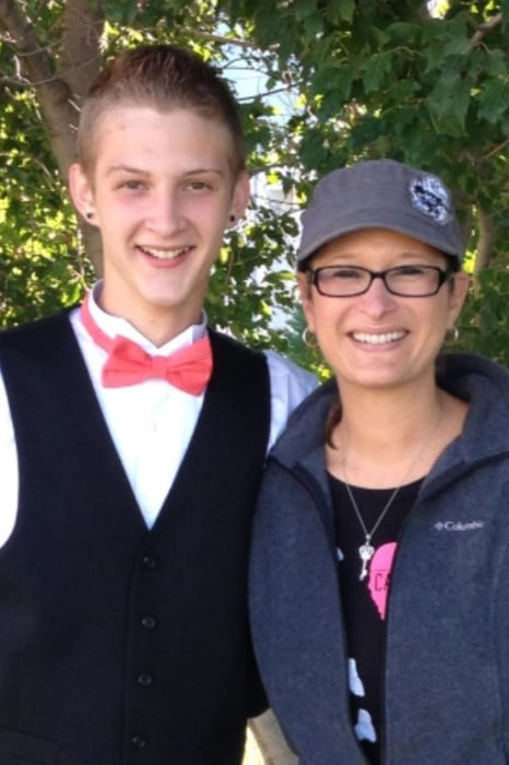 Image: 17-year-old Bryce Masters stands with his mother in an undated family photo.