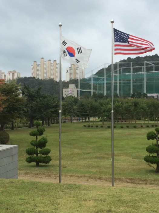 The Korean and American flags at the UN Cemetery in Busan, South Korea