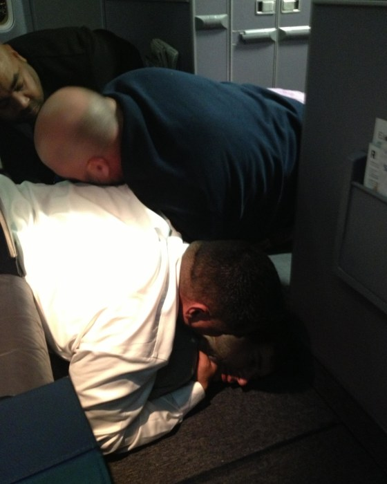 Image: A passenger is restrained  on United Flight 1074 (Dulles -> Denver) returned to Dulles Internation Airport After a passenger failed to comply with crew instructions.