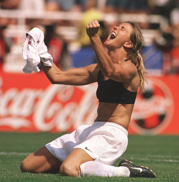 Image: United States' Brandi Chastain celebrates after kicking the game-winning overtime penalty shootout goal against China