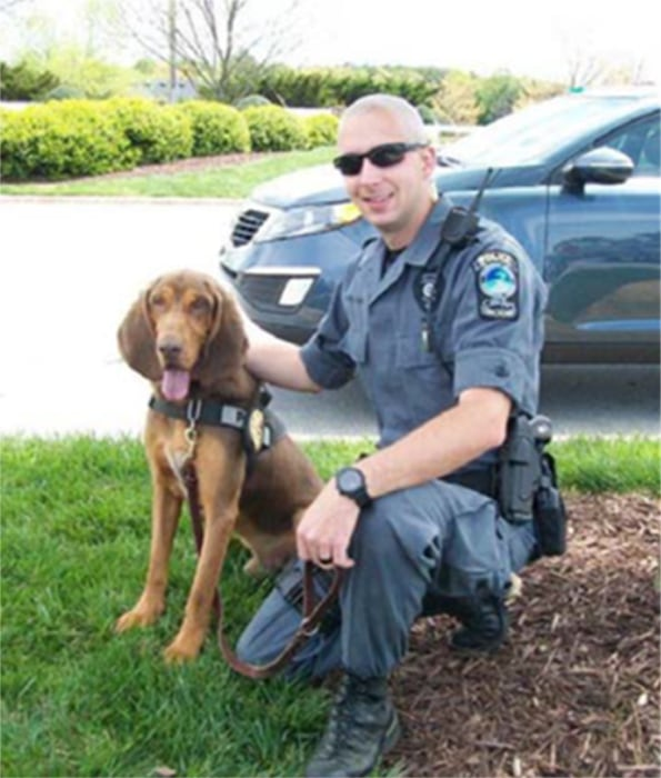 Imaqe: Zane, a 5-year-old bloodhound, died after spending seven hours in the back of Police Corporal Jerahmy Williams' patrol car.