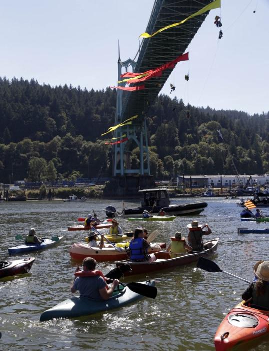 Image: Greenpeace activists hang from Portland bridge