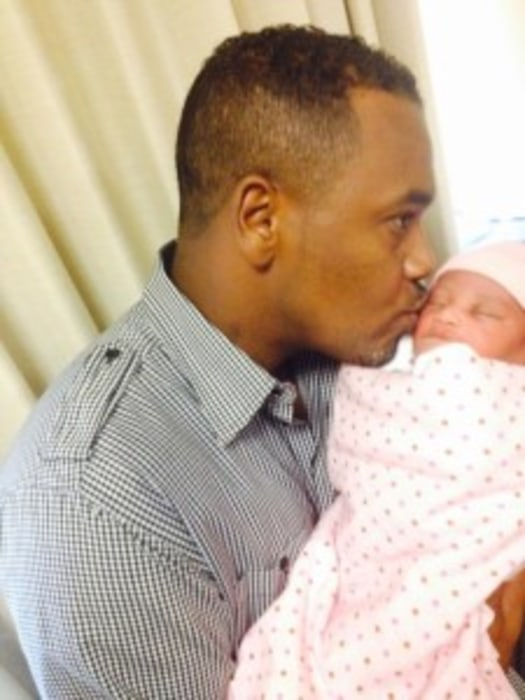 Image: Police released a photo of the unidentified father and his newborn girl.