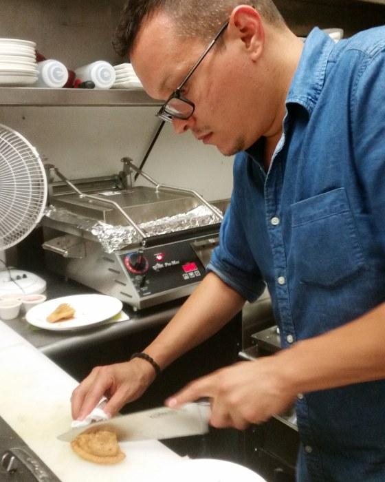Image: Alex Carabaño prepares a Philly style empanada